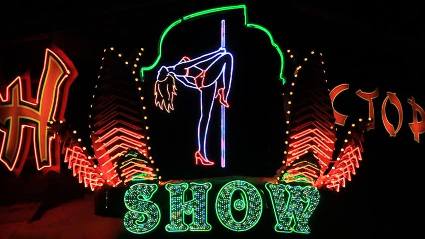 Strip show sign