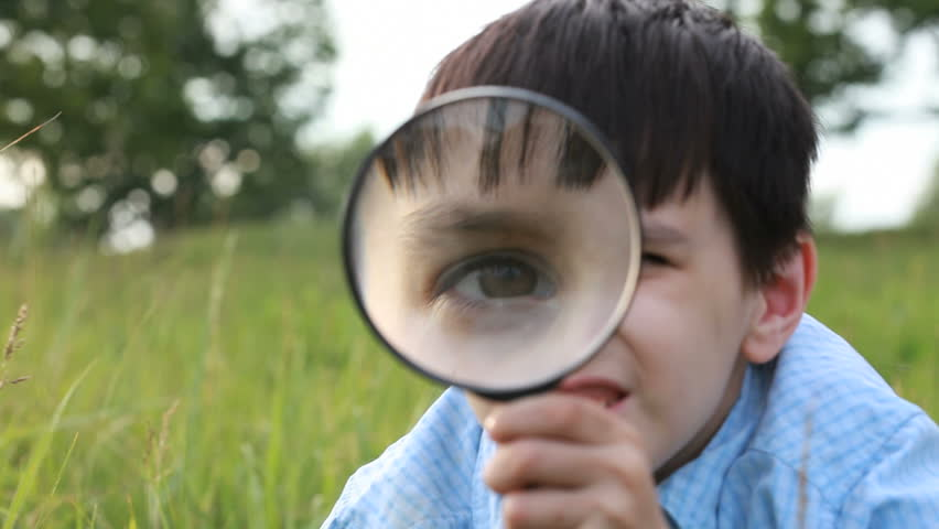 boy with magnifying glass  - HD stock footage clip