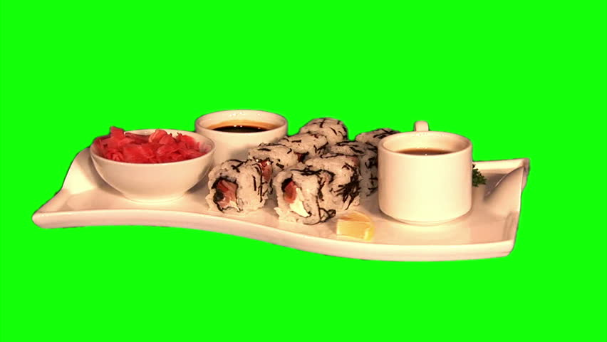 Sushi – rice, smoked salmon, tomato, cream cheese, celery (Chinese) cabbage, ginger, soy sauce and coffee on tray rotating on green screen, loop  - HD stock video clip
