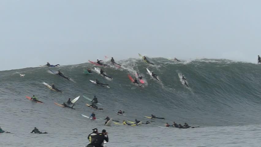Half Moon Bay, California, USA - Dec. 20, 2014: Big wave surfer, Tom Lowe, rides a giant wave at Mavericks surf break.