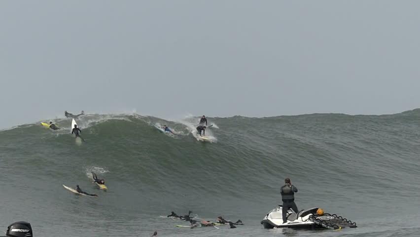 Half Moon Bay, California, USA - Dec. 20, 2014: Big wave surfer, Kyle Thiermann, falls while riding a giant wave at Mavericks surf break.