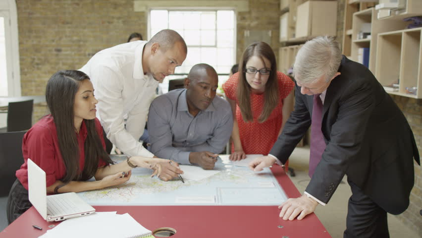 4K Mixed ethnicity business team in strategy meeting in modern office
