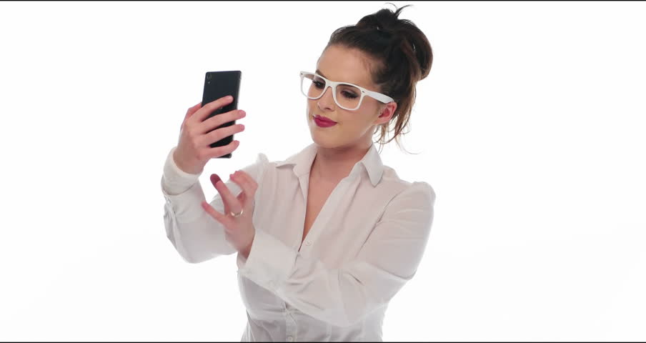 pretty girl  take a self portrait with her smart phone and show it to the camera video 4k - 4K stock footage clip
