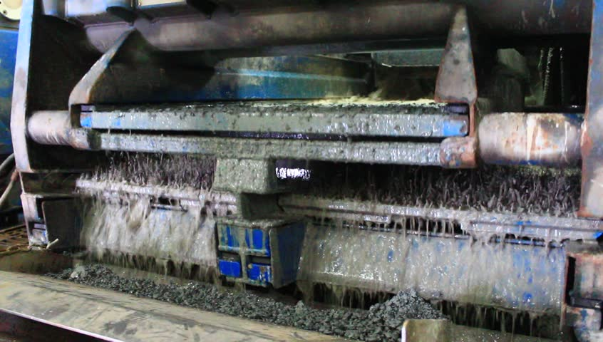 Shale shaker on an offshore oil rig separating the cutting from water based mud  - HD stock video clip