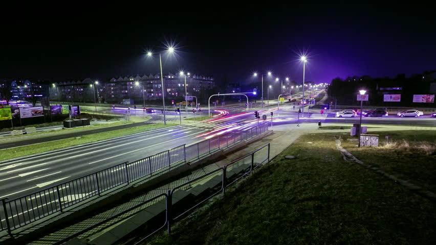 OLSZTYN - FEBRUARY 18, 2015 (Timelapse View). Crossroads of Tadeusza Ploskiego and Tomasza Wilczynskiego streets at night. Typical view of crossroad in polish town