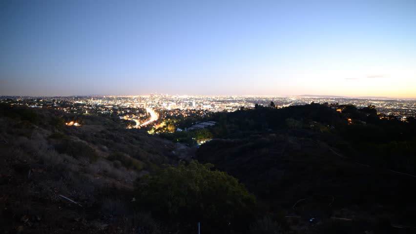 4K Time lapse footage with zoom in motion of Los Angeles cityscape at twilight wide shot in Los Angeles, California