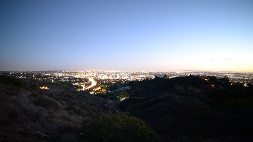 4K Time lapse footage with tilt down motion of Los Angeles cityscape at twilight wide shot in Los Angeles, California