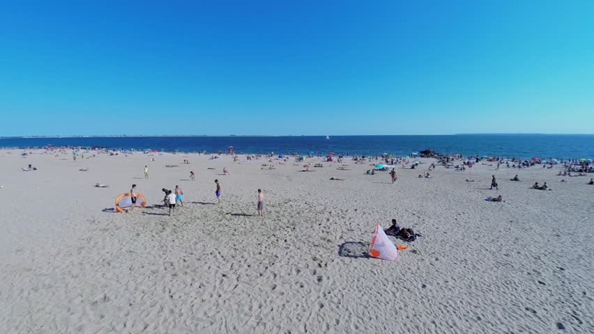 NEW-YORK - AUG 24, 2014: Group of men play soccer on Brighton Beach at summer sunny day. Aerial view. Brighton Beach is sometimes known as Little Odessa. - HD stock video clip