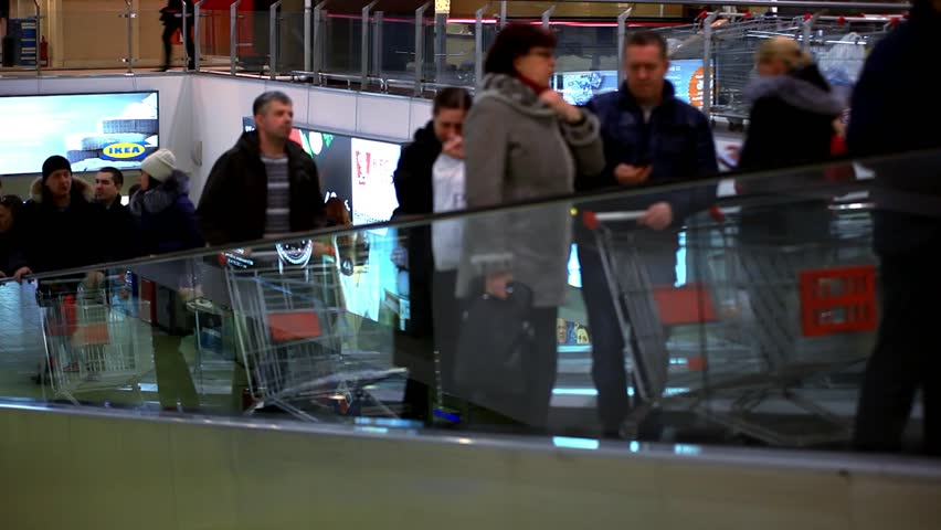 russia, moscow, 12 february, 2015. People with Shopping cart go shopping on escalator. HD. 1920x1080