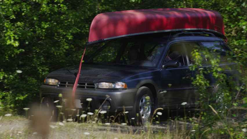 Family driving car to camp site