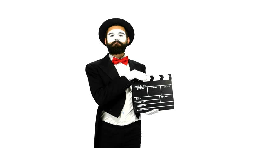 Happy, bearded, young man mime sneezes and using the movie clapper on white background