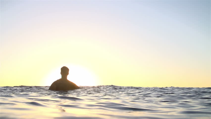 Slow Motion Surfer Waiting For Wave At Sunset  - HD stock video clip