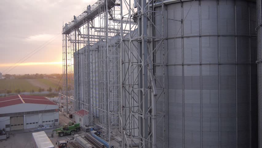 aerial view of modern farm silo stock footage video. Black Bedroom Furniture Sets. Home Design Ideas