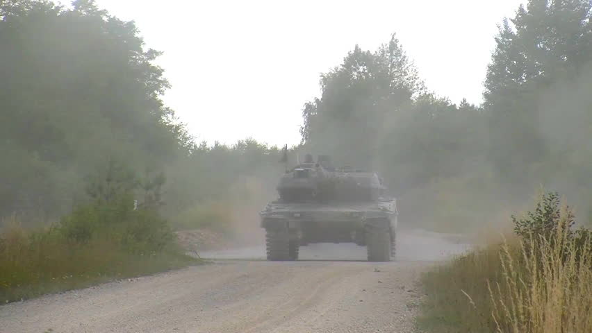 CIRCA 2010s - M 1 Abrams tank moves along a road.