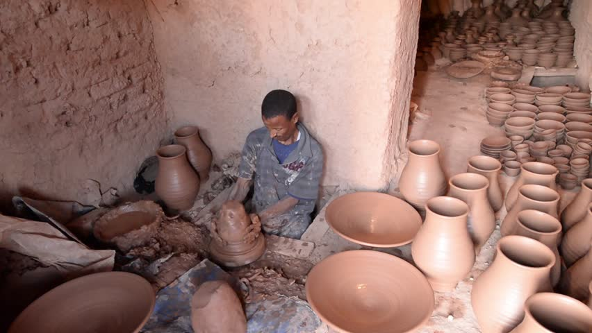 TAMEGROUTE, MOROCCO, MAY 13, 2014. A Moroccan man manifacturing plates and pots of clay at the famous Maison de poterie Tamegroute, Morocco, on May 13th, 2014.