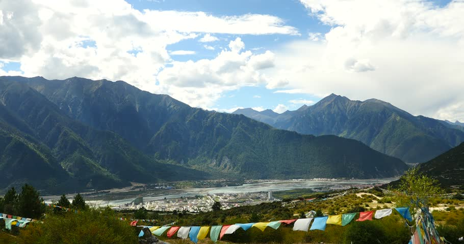 4k flying prayer flag with mountain in linzhi,aerial view of the second city of tibet,bayi town. gh2_09814_4k