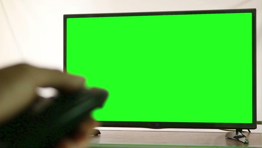 Smart tv and man pressing remote control, Green screen  - HD stock video clip