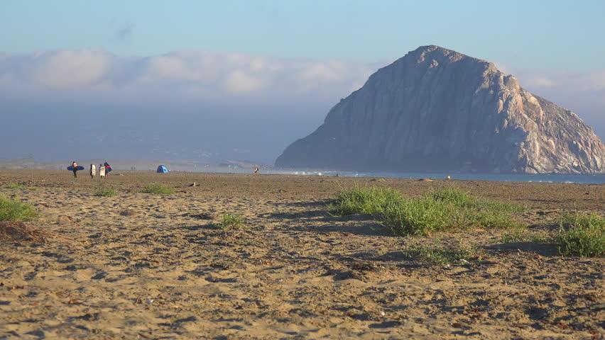 MORRO BAY, CALIFORNIA - CIRCA 2014 - The beautiful rock at Morro Bay California in golden sunset light. - 4K stock footage clip