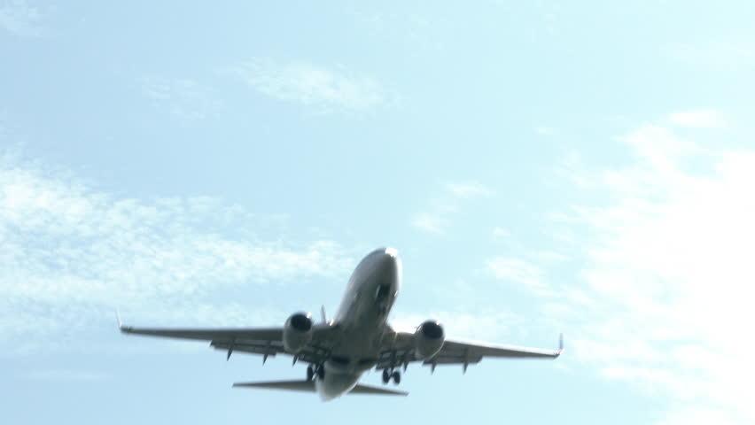4K Commercial airline plane flying overhead.