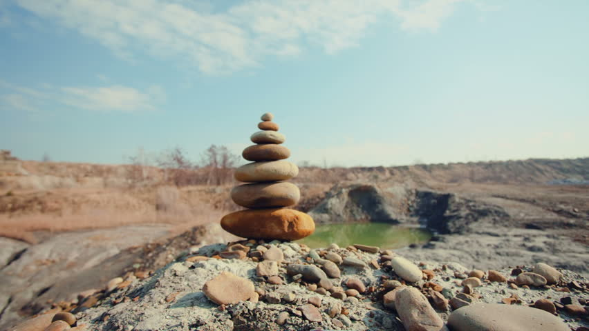 DOLLY MOTION: Stones balance. Spa or well-being, freedom and stability concept on rocks. - HD stock video clip