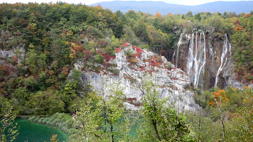 Majestic waterfall in scenic autumn landscape of Plitvice Lakes National Park in Croatia