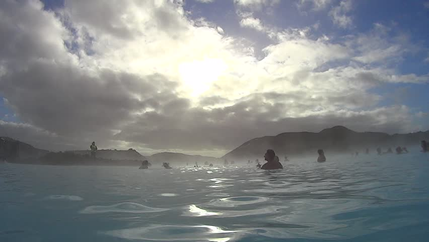 GRINDAVIK, ICELAND - MAR 21: People bathing in The Blue Lagoon on March 21, 2015 in Grindavik, Iceland. Blue Lagoon is most popular spa and geothermal bath resort in Iceland. - HD stock footage clip