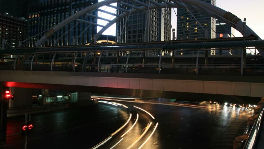 time lapse traffic at twilight time on Sathorn Road in bangkok Thailand