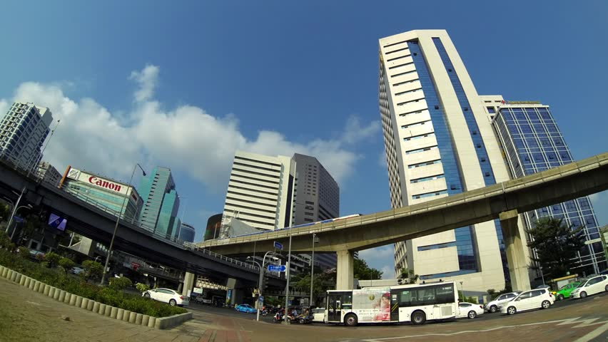 BANGKOK - March 2015: Bangkok's traffic with BTS sky trains passing by. 4K resolution time lapse. Silom - HD stock footage clip