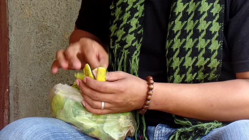 AGUINALDO, IFUGAO - APRIL 3, 2015: Mature adult young man chewing betel nut