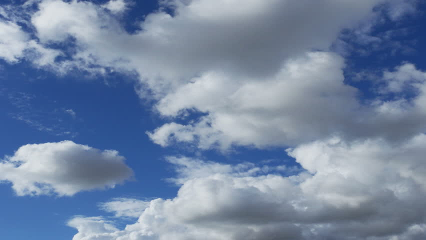 Time-lapse White Puffy Clouds with Clear Blue Sky (UltraHD 4K)