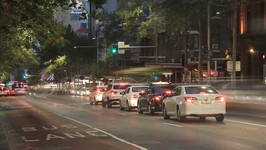 SYDNEY CITY, AUSTRALIA - MARCH 2015: Establishing Shot City Street Night Traffic and Pedestrian Time Lapse