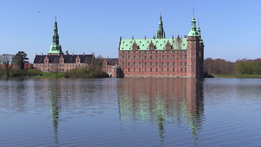 Frederiksborg Castle in Hilleroed near Copenhagen in Denmark. The castle is built in Dutch Renaissance style and is located on three islands in the castle lake. - HD stock video clip