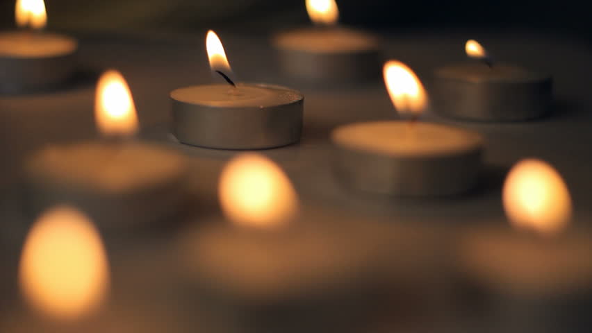 A lot of little candles burning, hope, tealight candles