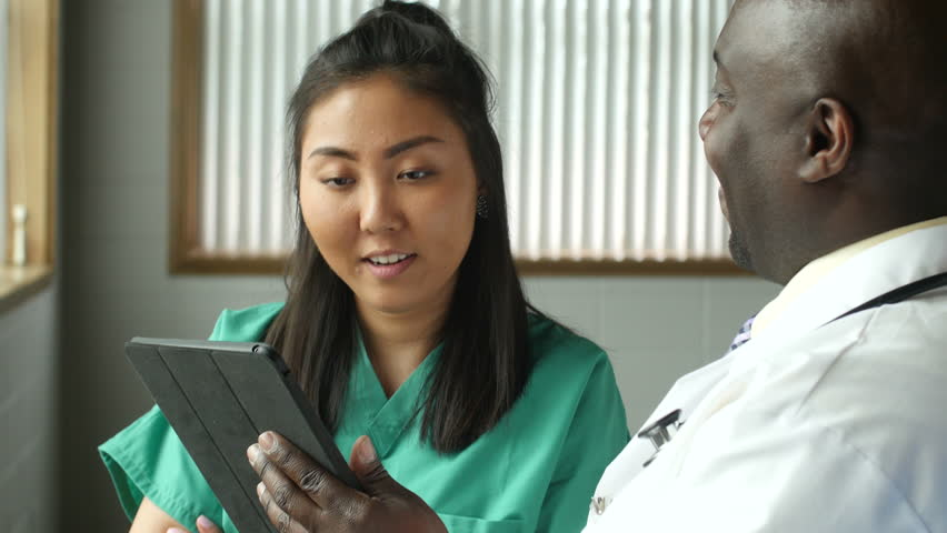 Multi-ethnic medical team with tablet