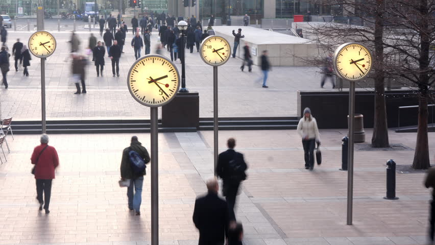 LONDON - MARCH 07: crowds of people rushing around in docklands, London's financial centre, London, UK. MARCH 07, 2009. (Time Lapse)