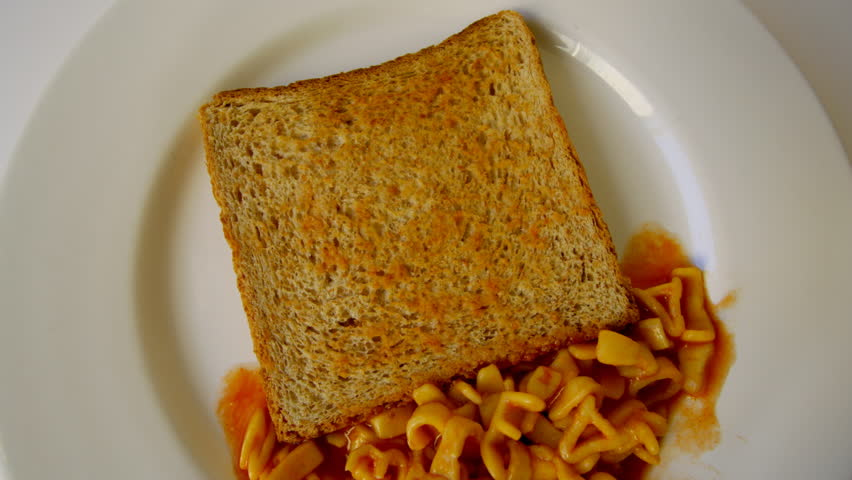 alphabet stop motion animation with spaghetti letters on toast - HD stock video clip