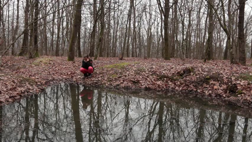 Sad Girl Next To Forest Pond, Tree Reflection In Water ...
