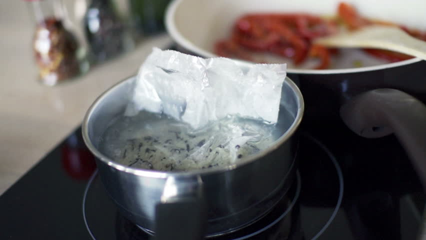 Cooking rice in pot in kitchen, slow motion shot at 240fps