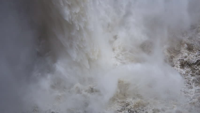 Extreme close up shot of the bottom part of a waterfall