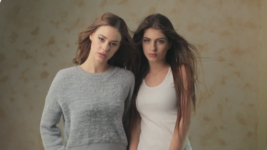 Two spectacular and beautiful models being photographed for the magazine